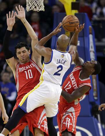 Golden State Warriors' Jarrett Jack (2) tries to shoot in front of Houston Rockets' Carlos Delfino (10) and Patrick Beverley (12) during the first half of an NBA basketball game in Oakland, Calif., Tuesday, Feb. 12, 2013. (AP Photo/Marcio Jose Sanchez) Photo: Marcio Jose Sanchez, Associated Press