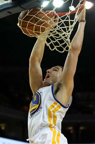 Golden State Warriors guard Klay Thompson (11) scores against the Houston Rockets in the first half of their NBA basketball game Tuesday, February 13, 2013. in Oakland Calif. Photo: Lance Iversen, The Chronicle