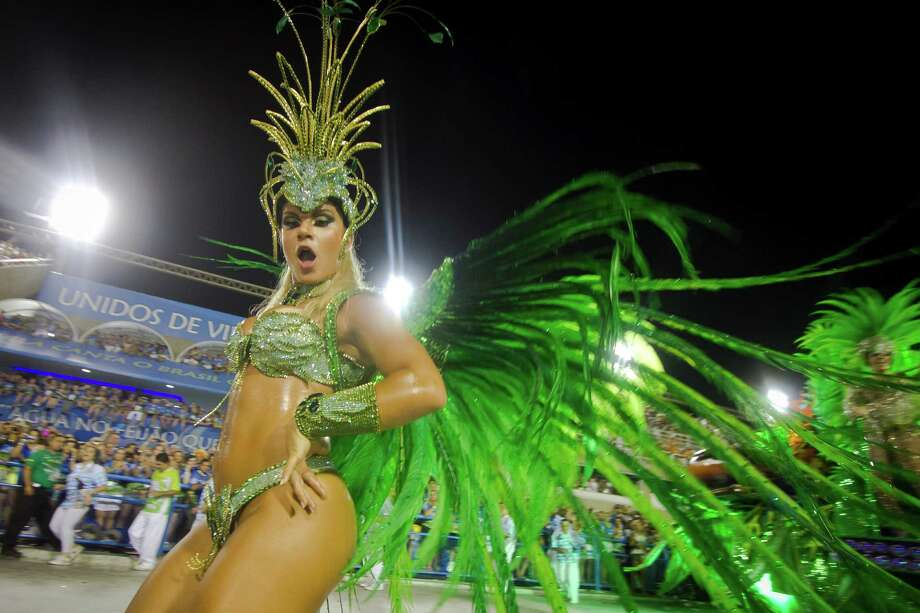 Members of Unidos de Vila Isabel dance during Carnival 2013 at Sambodrome Marques da Sapucai on February 12, 2013 in Rio de Janeiro, Brazil. Photo: Getty