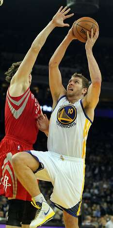 Golden State Warriors forward Davis Lee (10) shoots over the Houston Rockets Omer Asik (3) in the first half of their NBA basketball game Tuesday, February 13, 2013. in Oakland Calif. Photo: Lance Iversen, The Chronicle