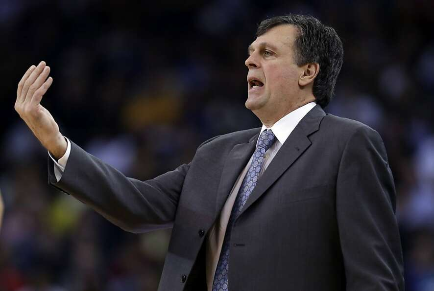 Houston Rockets coach Kevin McHale talks to his players during the first half of an NBA basketball g