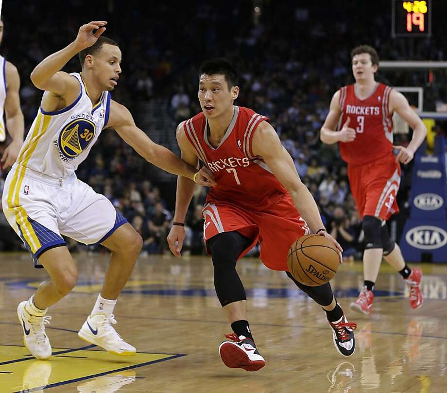 Houston Rockets' Jeremy Lin (7) tries to dribble past Golden State Warriors' Stephen Curry (30) during the first half of an NBA basketball game in Oakland, Calif., Tuesday, Feb. 12, 2013. (AP Photo/Marcio Jose Sanchez) Photo: Marcio Jose Sanchez, Associated Press