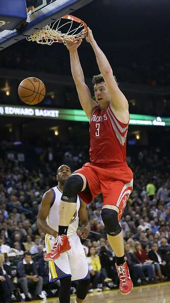 Houston Rockets' Omer Asik (3) dunks next to Golden State Warriors' Jarrett Jack during the first ha