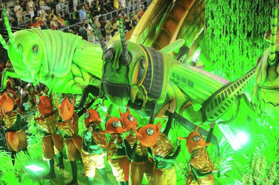 Rio de Janeiro's samba school Vila Isabel's dancers perform  along the Sambadrome on the second day of the traditional city's samba school parade on February 12, 2013.    AFP PHOTO ANTONIO SCORZA Photo: Getty