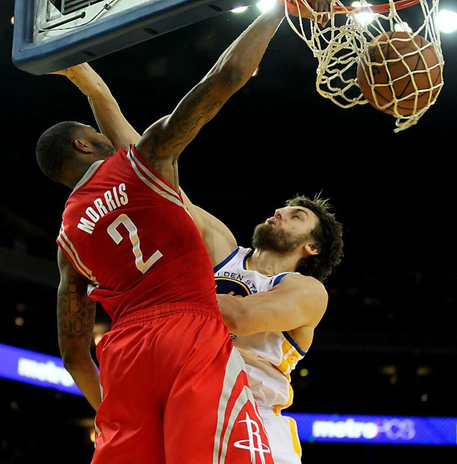 Houston Rockets forward Marcus Morris (2) scores over Golden State Warriors center Andrew Boggut (12) in the second half of their NBA basketball game Tuesday, February 13, 2013. in Oakland Calif. Rockets win 116 to 107 Photo: Lance Iversen, The Chronicle
