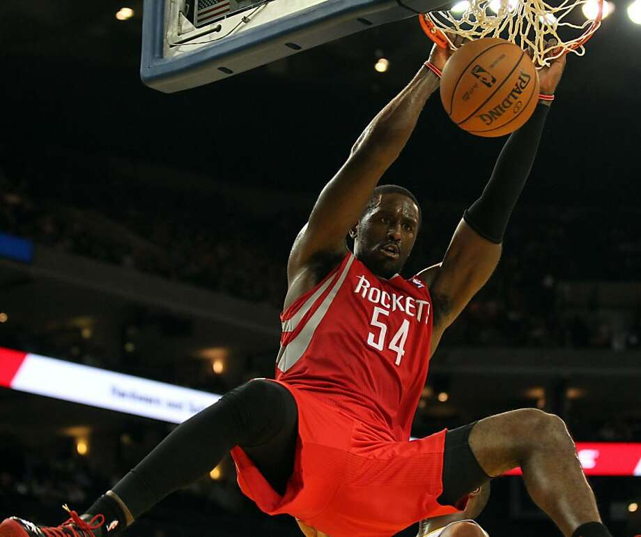 Houston Rockets forward Patrick Patterson (54) scores against the Golden State Warriors in the second half of their NBA basketball game Tuesday, February 13, 2013. in Oakland Calif. Rockets win 116 to 107 Photo: Lance Iversen, The Chronicle