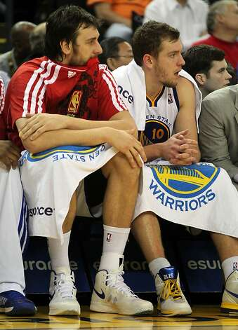 Golden State Warriors center Andrew Bogut and forward David Lee watch the game against the Houston Rockets from the bench in the second half of their NBA basketball game Tuesday, February 13, 2013. in Oakland Calif. Rockets win 116 to 107 Photo: Lance Iversen, The Chronicle