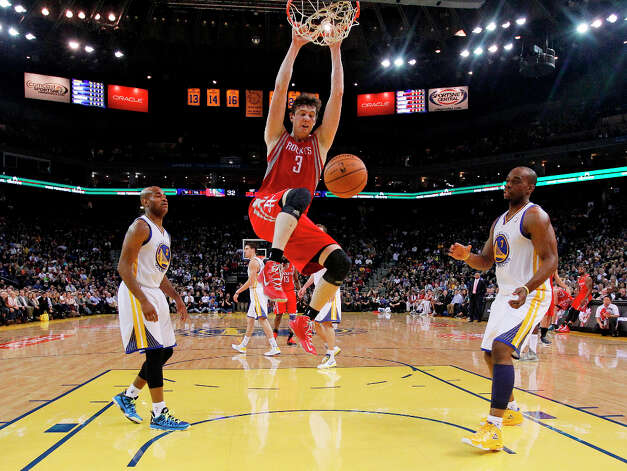 Rockets center Omer Asik slams the ball against the Warriors. Photo: Marcio Jose Sanchez