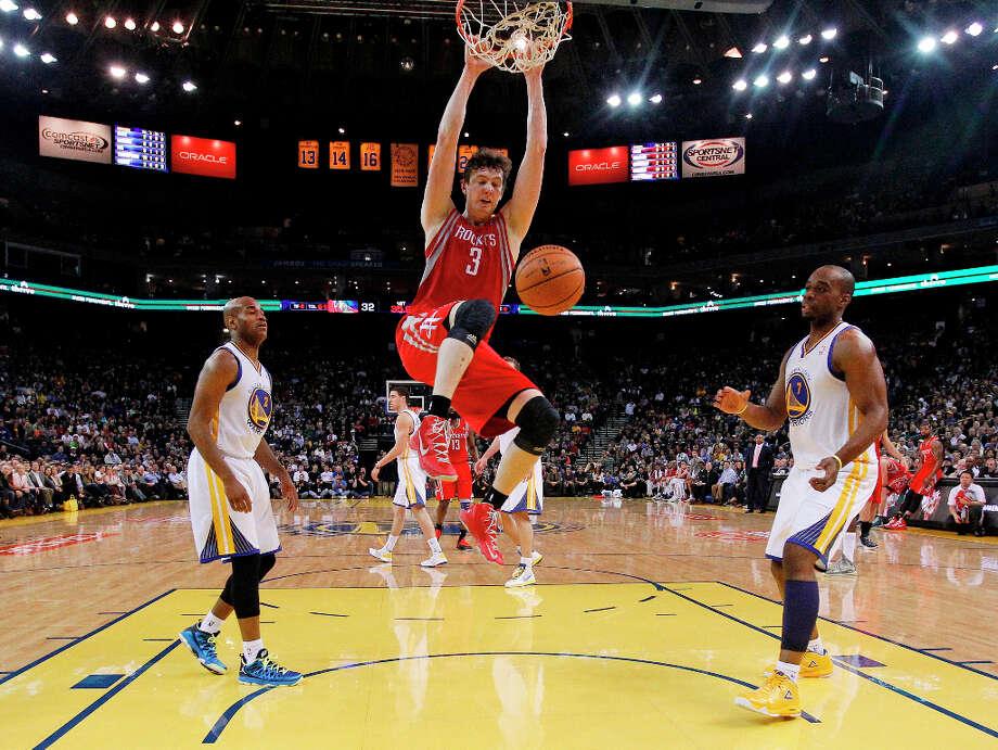 Rockets center Omer Asik slams the ball against the Warriors. Photo: Marcio Jose Sanchez