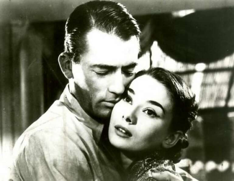 Joe Bradley (Gregory Peck) and Princess Ann (Audrey Hepburn) in Roman Holiday: The poor-man, rich-gi