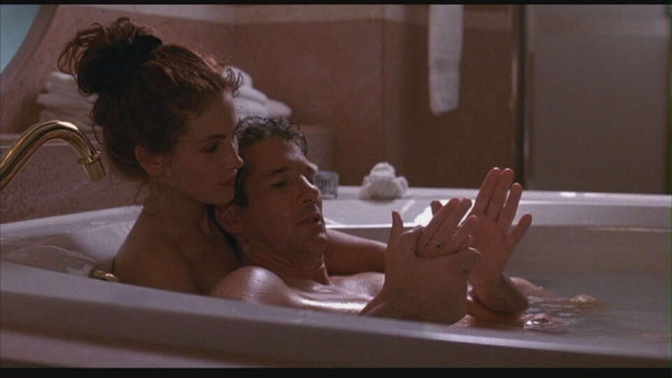 Edward Lewis (Richard Gere) and Vivian Ward (Julia Roberts) in Pretty Woman: He's a rich ruthless bu