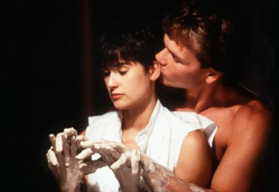 Sam Wheat (Patrick Swayze) and Molly Jensen (Demi Moore) in Ghost: The loving couple in this 1990 film maintains a close connection even after Sam dies. The pottery scene goes down as one of the most unique romance scenes ever.