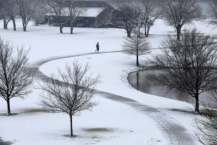 A lone jogger makes his way around a pond during the noon hour Tuesday Feb. 12, 2013 in Oklahoma City.   (AP Photo/The Oklahoman, Doug Hoke) LOCAL TV OUT (KFOR, KOCO, KWTV, KOKH, KAUT OUT); LOCAL INTERNET OUT; LOCAL PRINT OUT (EDMOND SUN OUT, OKLAHOMA GAZETTE OUT) TABLOIDS OUT Photo: Doug Hoke, Associated Press