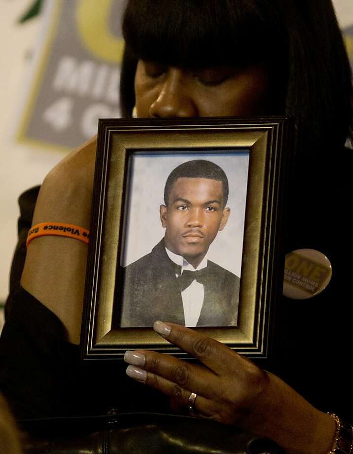 Yvette Forehand holds a portrait of her son Rory Forehand who was killed in a shooting in the East Harlem section of New York in 2007, during a One Million Moms for Gun Control rally at the Capitol on Tuesday, Feb. 12, 2013, in Albany, N.Y. They are supporting Gov. Andrew Cuomo and lawmakers for leadership on gun limits they expect to help reduce violence. (AP Photo/Mike Groll) Photo: Mike Groll, Associated Press