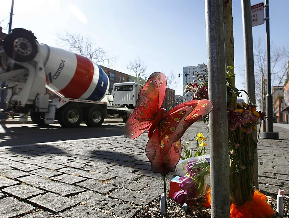 A memorial is arranged at the corner of Third and King streets, where Diana Sullivan was killed. The cement truck pictured in the background is owned by a different company from the one that was involved in the accident.