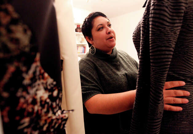 San Antonio fashion designer Mandi Gallegos will be showing her fall and winter collection at this year's New York Fashion Week. Gallegos discovered her talent for designing clothes later in life but relishes in the possibility of one day making high-end clothes for a living. The mother of two boys overcame a neurologic affliction and pursued her dream of designing and making clothes about six years ago. Gallegos calls her clothing design label, Mikailee Alton which bears portions of her family member's names. Photo: Kin Man Hui, San Antonio Express-News / © 2012 San Antonio Express-News