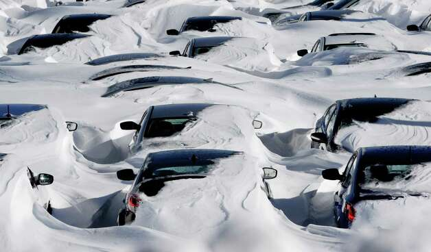 Snow begins to melt on cars parked at a dealership after a winter storm in Hartford, Conn., Sunday, Feb. 10, 2013.  A howling storm across the Northeast left much of the New York-to-Boston corridor covered with more than three feet of snow on Friday into Saturday morning. Photo: Jessica Hill