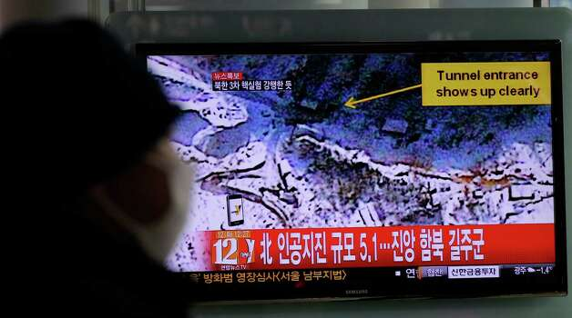 "A South Korean watches news reporting about a possible nuclear test conducted by North Korea on a TV screen at the Seoul train station in Seoul, South Korea, Tuesday, Feb. 12, 2013. The U.S. Geological Survey said Tuesday it had detected a magnitude 4.9 earthquake in North Korea, but neither Pyongyang nor Seoul confirmed whether North Korea had conducted its widely anticipated third nuclear test. The writing reads ""North, Artificial earthquake 5.1."" Photo: Lee Jin-man"