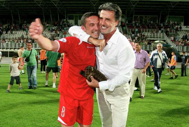 In this June 14, 2009 photo, Croatian soccer player Mario Cizmek, left, and his club president Zvonko Zubak celebrate victory in the national Cup match in Zagreb, Croatia. Cizmek was sentenced to 10 months in prison for involvement in match fixing scandal. Soccer player Mario Cizmek thought it would just be one match. Ease up and let the other team win, he told himself, then collect the payoff, and start clearing his debts. But the broke and desperate athlete soon learned that it wouldn't be just one match. He would have to throw another game, then another, then another.  CROATIA OUT Photo: AP