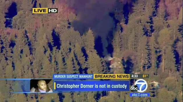 In this image taken from video provided by KABC-TV, the cabin in Big Bear, Calif. where ex-Los Angeles police officer Christopher Dorner is believed to be barricaded inside is in flames Tuesday, Feb. 12, 2013.  MANDATORY CREDIT: KABC-TV Photo: KABC-TV