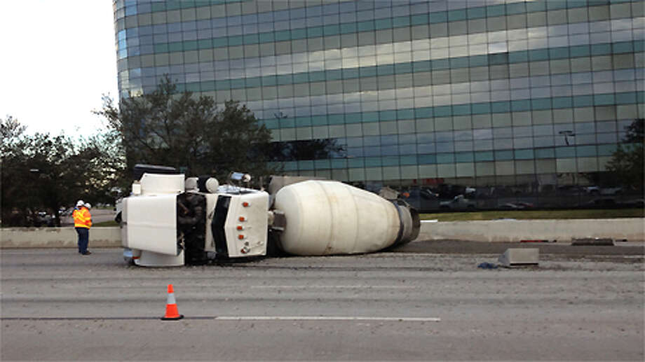The scene on U.S. 59 after a mixer truck overturned during an accident, spilling concrete on the roadway. Photo: Cory Heikkila / Houston Chronicle
