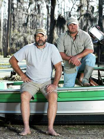 "Troy Broussard, left, and Harlan Hatcher have teamed up for 29 years to hunt alligators in Southeast Texas swamps. The are the newest cast members on the History Channel's ""Swamp People,"" which has its fourth season opener at 8 p.m. Thursday. Photo: History Channel, Swam People"