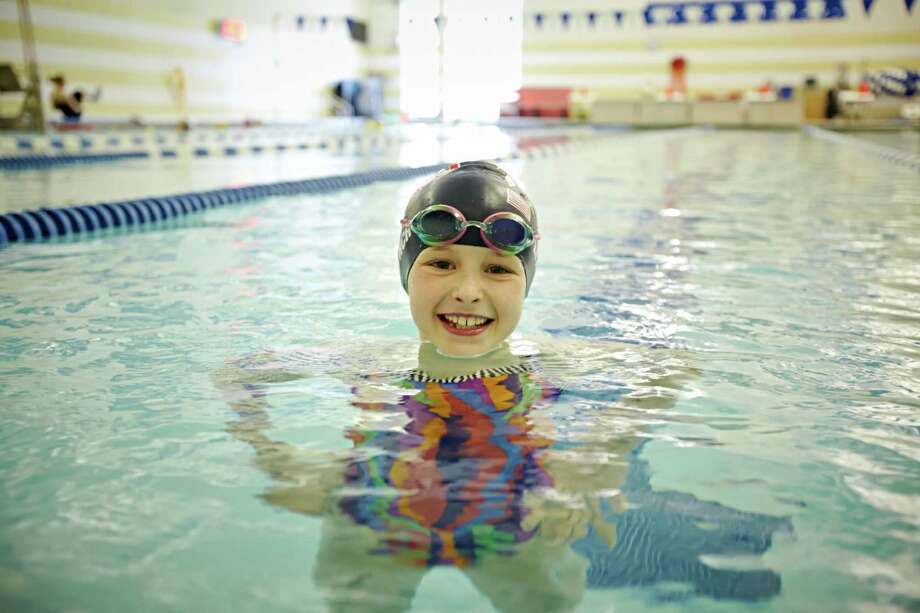 YWCA Greenwich Dolphins swim team member Meghan Lynch, 9, is making a name for herself in the pool. She recently took first place in the 9-year-old girls competition at the Eastern Region, USA Swimming-sponsored IM Xtreme Games, held at the University of Maryland, and her times in the 100-yard breast stroke and the 200-yard individual medley were the second fastest in the nation this year in the 9-year-old age group  . Photo: Contributed Photo / Greenwich Citizen