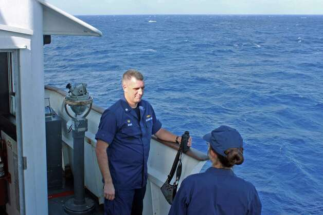 "This US Coast Guard photo obtained February 13, 2013 shows Cmdr.Greg Magee, captain of the Coast Guard Cutter Vigorous, as he talks with Lt. J.G. Alaina Kiskaddon while monitoring the situation during the tow of the disabled cruise ship Carnival Triumph, on February 12, 2013.  The Triumph reported a fire in the aft engine room Sunday morning, which was extinguished by the ships fire control system. The cruise ship packed with 4,200 travelers was adrift in the Gulf of Mexico for a third day on February 13, 2013 waiting to be towed into the US port of Mobile, Alabama, a company spokesman said. None of the 3,143 passengers and 1,086 crew aboard the 272-meter (893-foot) Carnival Triumph was injured in the fire that crippled the vessel on February 10, 2013. It is due to be taken into port in Mobile on Thursday instead of Progreso, Mexico, Vance Gulliksen, a spokesman for Carnival Cruise Lines, told AFP.  = RESTRICTED TO EDITORIAL USE - MANDATORY CREDIT "" AFP PHOTO / US COAST GUARD/DWAYNE BRADLEY/"" - NO MARKETING NO ADVERTISING CAMPAIGNS - DISTRIBUTED AS A SERVICE TO CLIENTS =Dwayne Bradley/AFP/Getty Images Photo: DWAYNE BRADLEY, AFP/Getty Images / AFP"