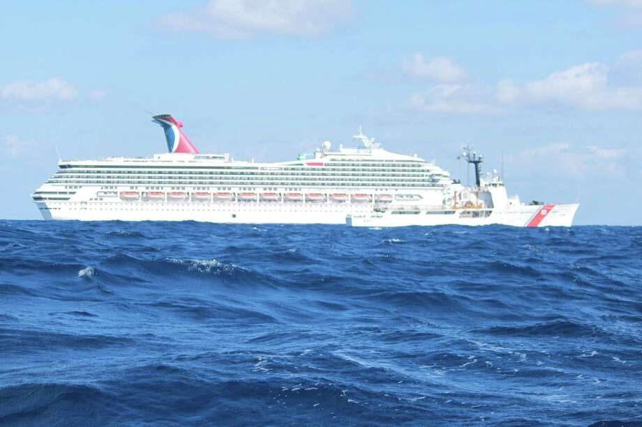 GULF OF MEXICO - FEBRUARY 11:  In this handout from the U.S. Coast Guard, the cruise ship Carnival Triumph sits idle February 11, 2013 in the Gulf of Mexico. According to the Coast Guard, the ship lost propulsion power February 10, after a fire broke out in the engine room. Photo: U.S. Coast Guard, Getty Images / 2013 U.S. Coast Guard