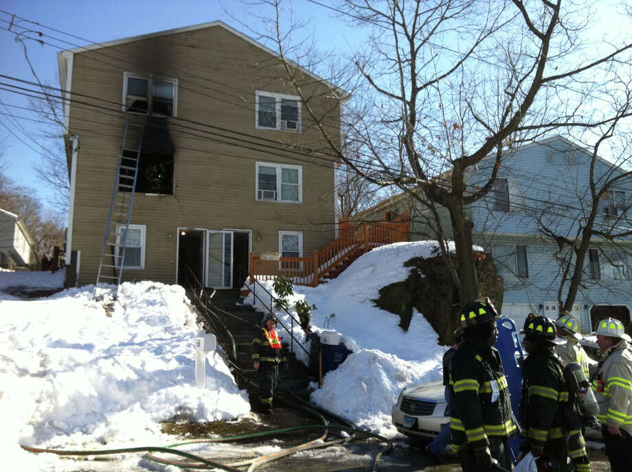 Police and fire crews on the scene of a fire at a Roberts Street house, Feb. 13 where shots were reportedly fired shortly before 10 a.m. Photo: Ned Gerard