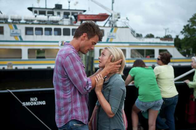 "This film image released by Relativity Media shows Julianne Hough, right, and Josh Duhamel in a scene from ""Safe Haven."" (AP Photo/Relativity Media, James Bridges) Photo: James Bridges / Relativity Media"