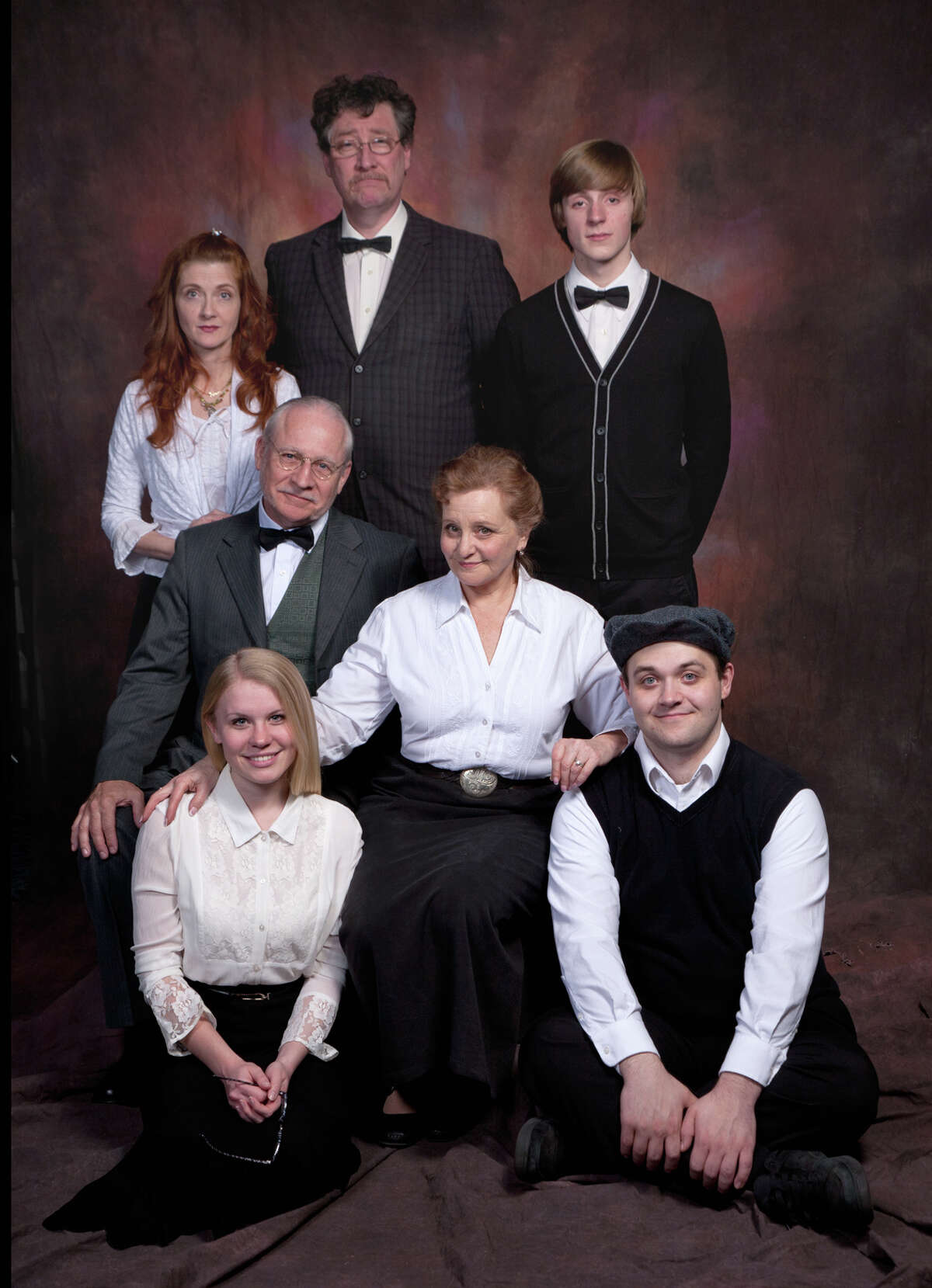 """The Miller clan from Eugene O'Neill's classic comedy of American family life, """"Ah, Wilderness!"""" Pictured from left to right: Top Row--Janet Hurley Kimlicko, Brian Massman, Dan Light; Second Row-- Ron Komora, Eileen Schuyler; Bottom Row--Kristyn Youngblood, Evan Jones. Theater Voices will present a staged reading of the play, directed by Carol Charniga, on Friday February 15 at 8pm; Saturday February 16 at 3 & 8pm, and Sunday February 17 at 3pm at Steamer No. 10 Theatre, 500 Western Avenue Albany, 438-5503. Admission is free. Please credit: Photo by Joe Schuyler"""