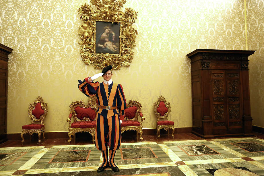 A Swiss guard stands on attention during the courtesy visits to the new appointed cardinals at the Apostolic Palace on November 24,  2012 in Vatican City, Vatican. Pope Sixtus V (1585- 1590) built the Apostolic Palace where the present pope lives and where every Sunday at noon he stands at the window, and blesses the crowd that gathers in the magnificent St. Peter's square. Photo: Franco Origlia, Getty Images / 2013 Franco Origlia