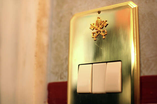A dedicated button switch of Pope Benedict XVI private studio at the Apostolic Palace on December 17, 2012 in Vatican City, Vatican. Pope Sixtus V (1585- 1590) built the Apostolic Palace where the present pope lives and where every Sunday at noon he stands at the window, and blesses the crowd that gathers in the magnificent St. Peter's square. Photo: Franco Origlia, Getty Images / 2013 Franco Origlia