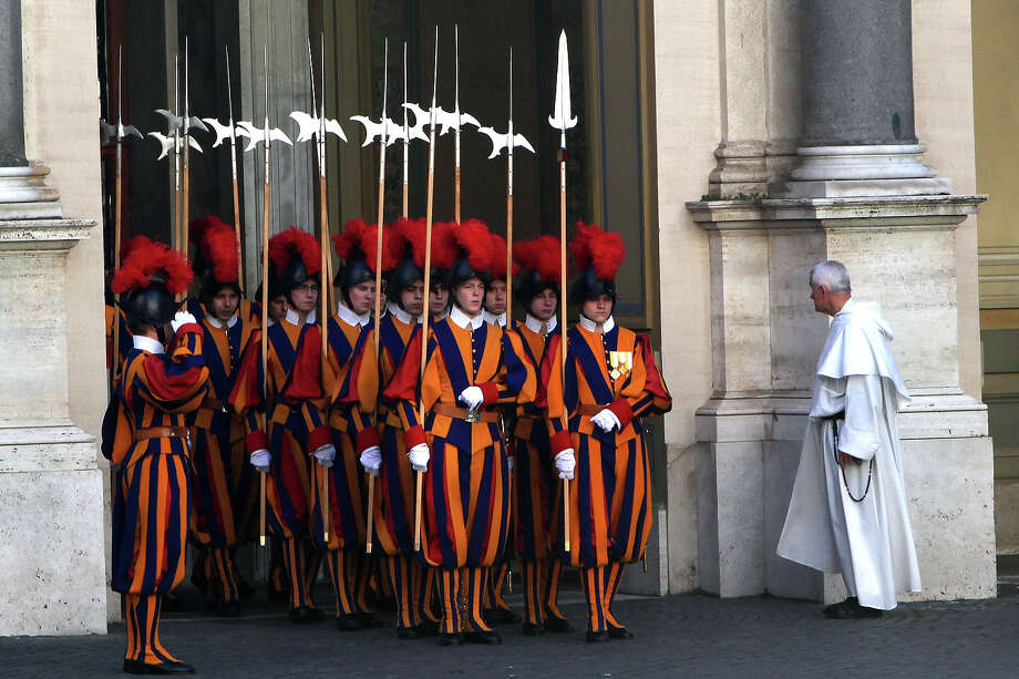 Swiss guards arrive at the Cortile di San Damaso of the Apostolic Palace at the Apostolic Palace on December 17, 2012 in Vatican City, Vatican. Pope Sixtus V (1585- 1590) built the Apostolic Palace where the present pope lives and where every Sunday at noon he stands at the window, and blesses the crowd that gathers in the magnificent St. Peter's square. Photo: Franco Origlia, Getty Images / 2013 Franco Origlia