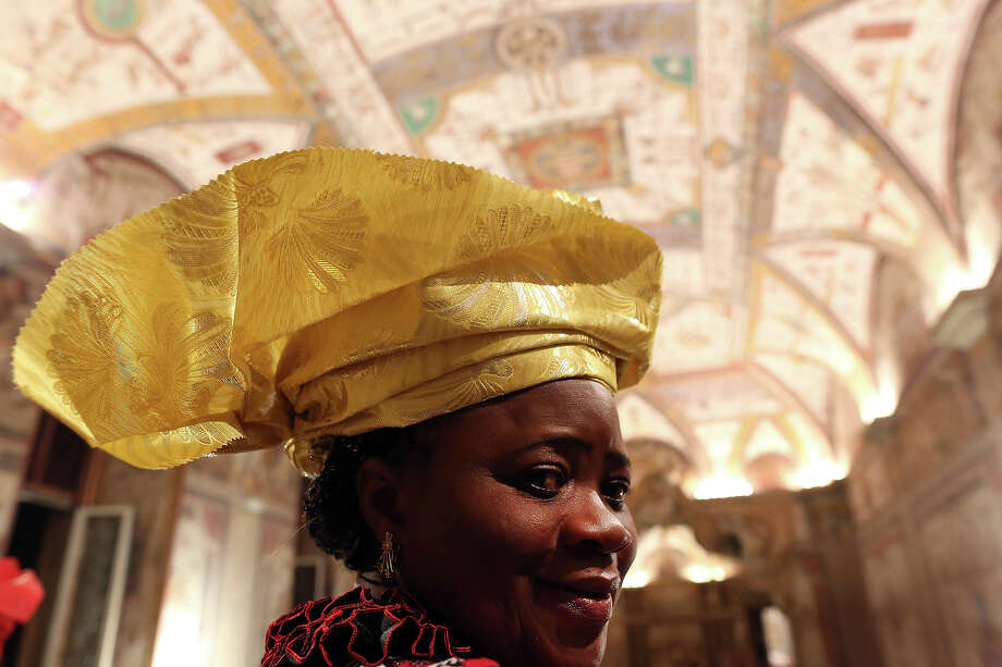 A faithful from Africa visits the Ducale's Hall during the courtesy visits to the new appointed cardinals at the Apostolic Palace on November 24,  2012 in Vatican City, Vatican. Pope Sixtus V (1585- 1590) built the Apostolic Palace where the present pope lives and where every Sunday at noon he stands at the window, and blesses the crowd that gathers in the magnificent St. Peter's square. Photo: Franco Origlia, Getty Images / 2013 Franco Origlia