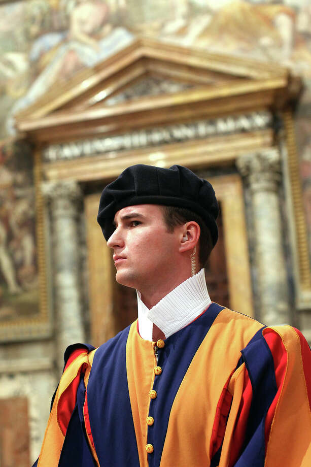 A Swiss guard stands at the Throne's Hall during the courtesy visits to the new appointed cardinals at the Apostolic Palace on November 24,  2012 in Vatican City, Vatican. Pope Sixtus V (1585- 1590) built the Apostolic Palace where the present pope lives and where every Sunday at noon he stands at the window, and blesses the crowd that gathers in the magnificent St. Peter's square. Photo: Franco Origlia, Getty Images / 2013 Franco Origlia