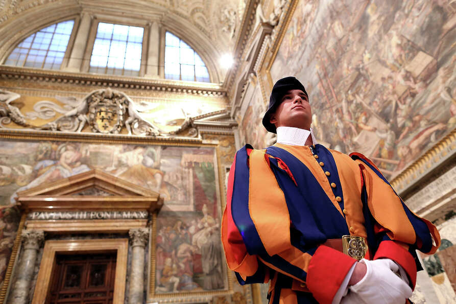 A Swiss guard stands at the Throne's Hall during the courtesy visits to the new appointed cardinals