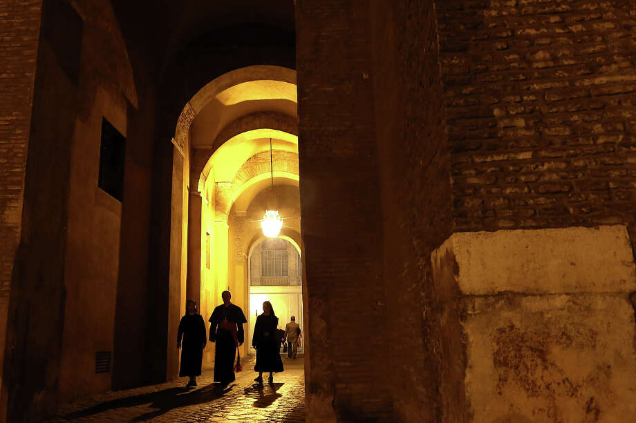 A view of the arc to the Cortile di San Damaso during the courtesy visits to the new appointed cardinals at the Apostolic Palace on November 24,  2012 in Vatican City, Vatican. Pope Sixtus V (1585- 1590) built the Apostolic Palace where the present pope lives and where every Sunday at noon he stands at the window, and blesses the crowd that gathers in the magnificent St. Peter's square. Photo: Franco Origlia, Getty Images / 2013 Franco Origlia
