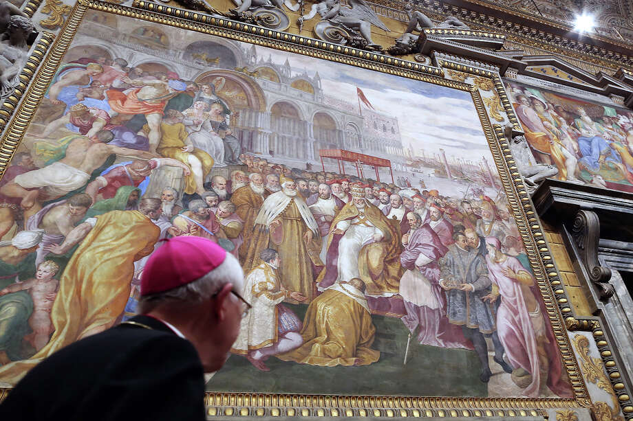 A bishop walks below Throne's Hall paintings during the courtesy visits to the new appointed cardinals at the Apostolic Palace on November 24,  2012 in Vatican City, Vatican. Pope Sixtus V (1585- 1590) built the Apostolic Palace where the present pope lives and where every Sunday at noon he stands at the window, and blesses the crowd that gathers in the magnificent St. Peter's square. Photo: Franco Origlia, Getty Images / 2013 Franco Origlia