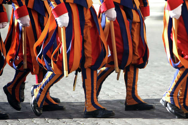 Swiss guards arrive at the Cortile di San Damaso of the Apostolic Palace on October 25,  2012 in Vatican City, Vatican. Pope Sixtus V (1585- 1590) built the Apostolic Palace where the present pope lives and where every Sunday at noon he stands at the window, and blesses the crowd that gathers in the magnificent St. Peter's square. Photo: Franco Origlia, Getty Images / 2013 Franco Origlia