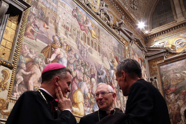 Bishops talk below Throne's Hall paintings during the courtesy visits to the new appointed cardinals at the Apostolic Palace on November 24,  2012 in Vatican City, Vatican. Pope Sixtus V (1585- 1590) built the Apostolic Palace where the present pope lives and where every Sunday at noon he stands at the window, and blesses the crowd that gathers in the magnificent St. Peter's square. Photo: Franco Origlia, Getty Images / 2013 Franco Origlia
