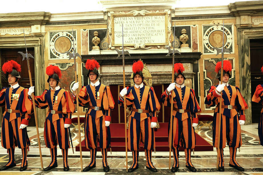 Swiss guards stand on attention in the Clementina Hall at the Apostolic Palace on October 29, 2012 in Vatican City, Vatican. Pope Sixtus V (1585- 1590) built the Apostolic Palace where the present pope lives and where every Sunday at noon he stands at the window, and blesses the crowd that gathers in the magnificent St. Peter's square. Photo: Franco Origlia, Getty Images / 2013 Franco Origlia