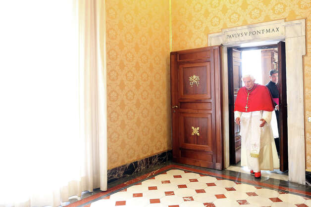 Pope Benedict XVI leaves his studio at the Apostolic Palace to attend an audience on October 25, 2012 in Vatican City, Vatican. Pope Sixtus V (1585- 1590) built the Apostolic Palace where the present pope lives and where every Sunday at noon he stands at the window, and blesses the crowd that gathers in the magnificent St. Peter's square. Photo: Franco Origlia, Getty Images / 2013 Franco Origlia