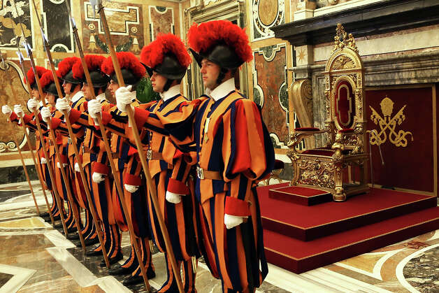 Swiss guards stand on attention in the Clementina Hall at the Apostolic Palace on October 29  2012 in Vatican City, Vatican. Pope Sixtus V (1585- 1590) built the Apostolic Palace where the present pope lives and where every Sunday at noon he stands at the window, and blesses the crowd that gathers in the magnificent St. Peter's square. Photo: Franco Origlia, Getty Images / 2013 Franco Origlia