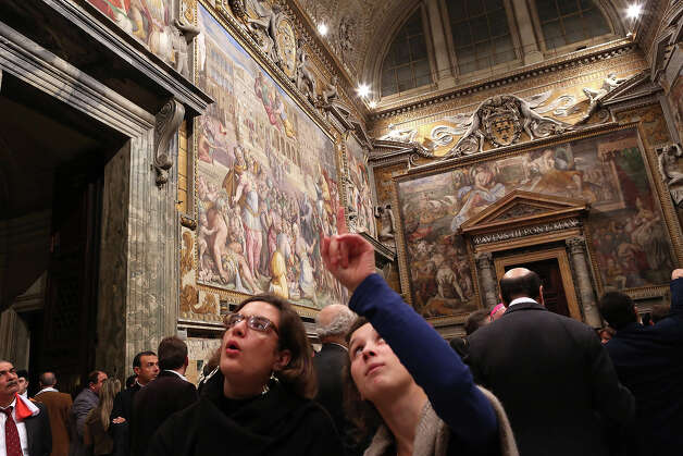 The faithful admire the Throne's Hall paintings during the courtesy visits to the new appointed cardinals at the Apostolic Palace on November 24,  2012 in Vatican City, Vatican. Pope Sixtus V (1585- 1590) built the Apostolic Palace where the present pope lives and where every Sunday at noon he stands at the window, and blesses the crowd that gathers in the magnificent St. Peter's square. Photo: Franco Origlia, Getty Images / 2013 Franco Origlia