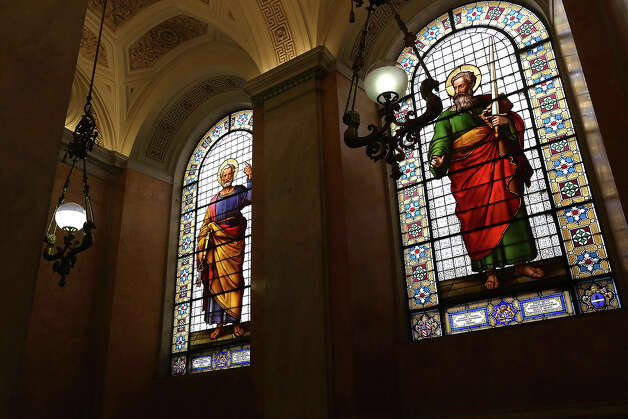 Window mosaics featuring St. Peter and St Paul are seen in the Apostolic Palace staircase on October 29, 2012 in Vatican City, Vatican. Pope Sixtus V (1585- 1590) built the Apostolic Palace where the present pope lives and where every Sunday at noon he stands at the window, and blesses the crowd that gathers in the magnificent St. Peter's square. Photo: Franco Origlia, Getty Images / 2013 Franco Origlia