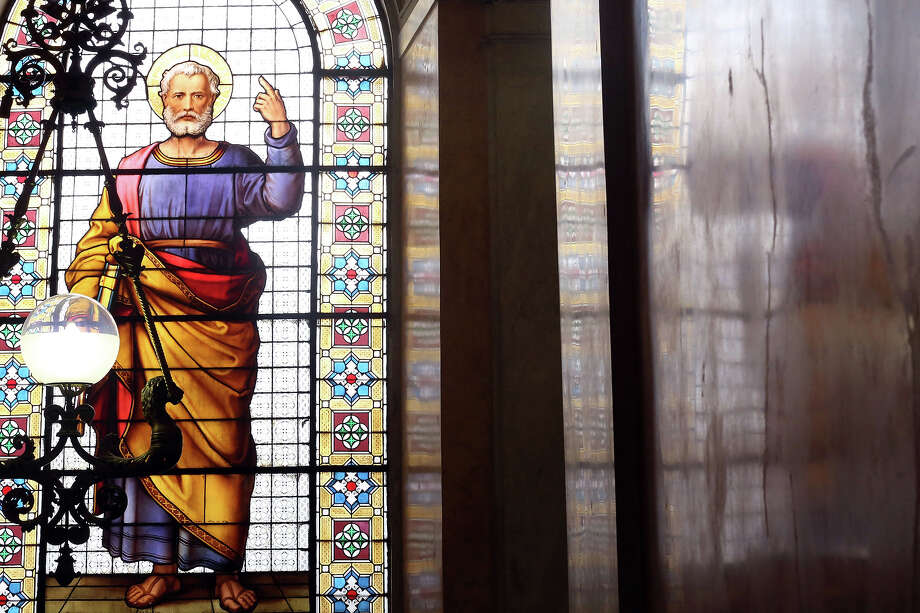 A window mosaic featuring St. Peter is seen in the Apostolic Palace staircase on December 17,  2012 in Vatican City, Vatican. Pope Sixtus V (1585- 1590) built the Apostolic Palace where the present pope lives and where every Sunday at noon he stands at the window, and blesses the crowd that gathers in the magnificent St. Peter's square. Photo: Franco Origlia, Getty Images / 2013 Franco Origlia