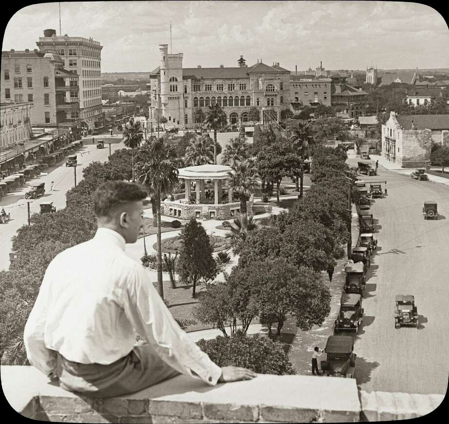 "In this image from the 1920s, readers of ""Downtown San Antonio"" can look over the shoulder of this unknown man at Alamo Plaza. Photo: Courtesy Arcadia Publishing"