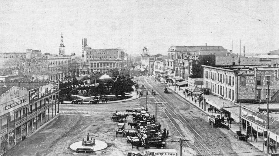 The view looking south at Alamo Plaza in 1898. The building on the left, owned by Hugo Schmeltzer & Co., became part of the Alamo grounds after being purchased and donated by Clara Driscoll. Photo: Courtesy Arcadia Publishing